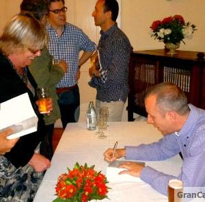 Mr Gran Canaria Local signs a copy of Going Local in Gran Canaria