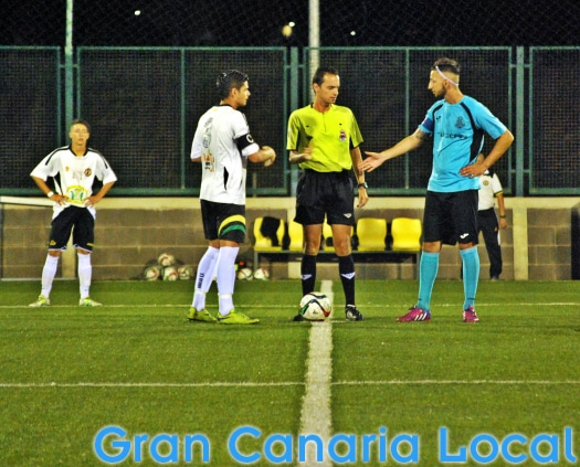 The Arucas CF and CD Carnevali captains prior to kick off
